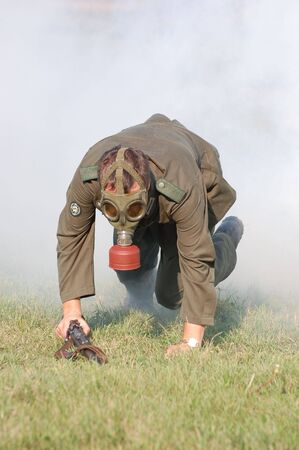 German soldier in gas mask.WW2 historical reenactment photo