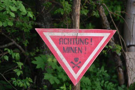 achtung: Achtung minen sign. WW2 reenactment  Stock Photo