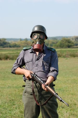 German soldier in gas mask . WW2 reenacting  photo
