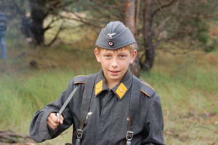 nazism: CHERNIGOW, UKRAINE - AUG 29: Member of Red Star military history club wears historical German uniform during historical reenactment of WWII, August 29, 2010 in Chernigow, Ukraine