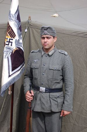 chernigow: CHERNIGOW, UKRAINE - AUG 29: Member of Red Star military history club wears historical German uniform during historical reenactment of WWII, August 29, 2010 in Chernigow, Ukraine