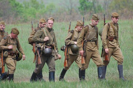 KIEV, UKRAINE - MAY 10 : Members of Red Star history club wear historical Soviet uniform during historical reenactment of 1945 WWII, May 10, 2010 in Kiev, Ukraine  Stock Photo - 7960758
