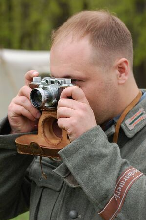 bullet camera: KIEV, UKRAINE - MAY 9: A member of a military history club wears a historical German uniform as he participates in a WWII reenactment May 9, 2008 in Kiev, Ukraine