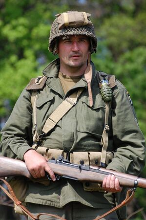 KIEV, UKRAINE - MAY 9: A member of military history club Red Star in American uniform during historical military reenactment of War in Germany of May 1945 May 9, 2009 in Kiev, Ukraine.