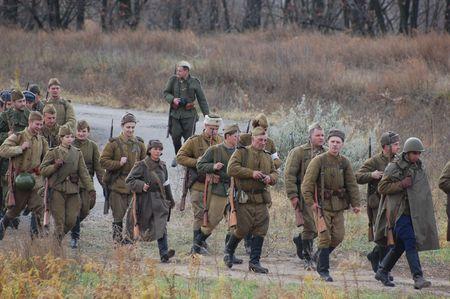 reenaction: KIEV, UKRAINE - NOV 7: members of Red Star history club wear historical Soviet uniform during historical reenactment of Kiev Liberation in 1943, November 7, 2010 in Kiev, Ukraine