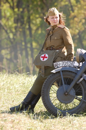 Girl wears Soviet uniform of WWII photo