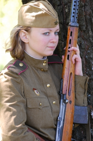 Girl wears Soviet uniform of WWII photo