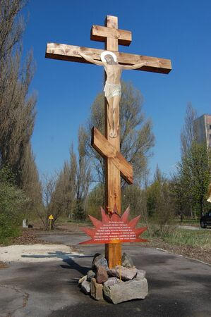 Chernobyl area.Cross in memory of city. Lost city Pripyat. Modern ruins. Ukraine. Kiev region photo