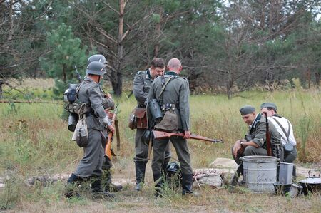 chernigow: CHERNIGOW, UKRAINE - AUG 29: Members of Red Star military history club wear historical German uniform during historical reenactment of WWII, August 29, 2010 in Chernigow, Ukraine