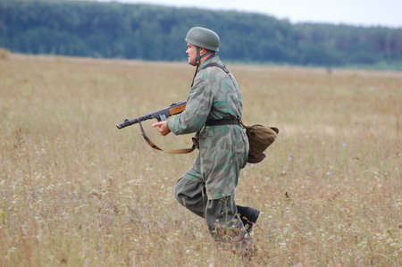 chernigow: CHERNIGOW, UKRAINE - AUG 29: A member of Red Star military history club wears historical German paratrooper uniform during historical reenactment of WWII, August 29, 2010 in Chernigow, Ukraine  Editorial