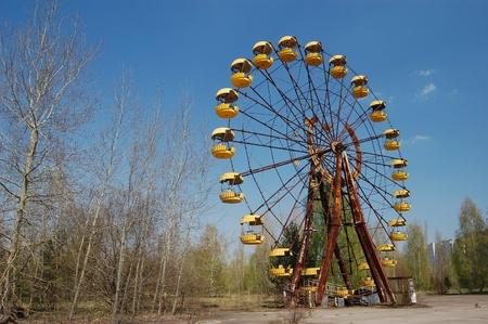 radium: APR. 25,2009 Chernobyl area. Lost city Pripyat. Ferris wheel in Pripyat.Modern ruins. Ukraine. Kiev region.April 25,2009