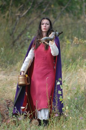weaponry: KIEV, UKRAINE - JULY 31: Member of history club Golden Capricorn wears medieval costume as she participates in historical festival and camp in memory of King Vladimir July 31, 2009 in Kiev, Ukraine.  Editorial
