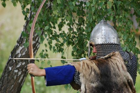 bowman: KIEV, UKRAINE - JULY 31: Member of history club Golden Capricorn wears medieval costume as he participates in historical festival and camp in memory of King Vladimir July 31, 2009 in Kiev, Ukraine