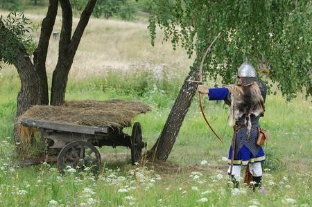 weaponry: KIEV, UKRAINE - JULY 31: Member of history club Golden Capricorn wears medieval costume as he participates in historical festival and camp in memory of King Vladimir July 31, 2009 in Kiev, Ukraine