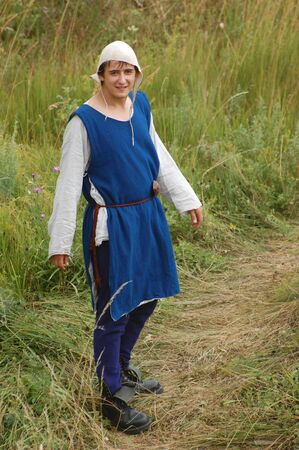 weaponry: KIEV, UKRAINE - JULY 31: Member of history club Golden Capricorn wears medieval costume as he participates in historical festival and camp in memory of King Vladimir July 31, 2009 in Kiev, Ukraine.