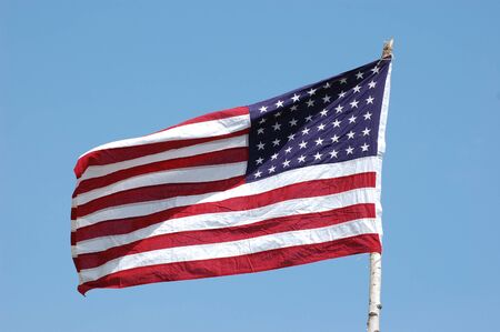 American flag flapping, with clear sky background, horizontal Stock Photo - 8471079
