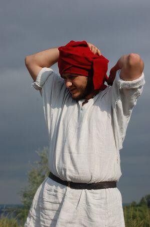 KIEV, UKRAINE - JULY 31: Member of history club Golden Capricorn wears medieval costume as he participates in historical festival and camp in memory of King Vladimir July 31, 2009 in Kiev, Ukraine.  Stock Photo - 8502011