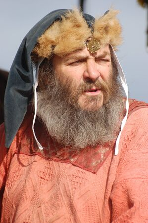 KIEV, UKRAINE - JULY 31: Member of history club Golden Capricorn wears medieval costume as he participates in historical festival and camp in memory of King Vladimir July 31, 2009 in Kiev, Ukraine.  Stock Photo - 8502108