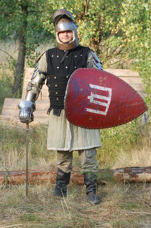 armament: KIEV, UKRAINE - JULY 31: Member of history club Golden Capricorn wears medieval costume as he participates in historical festival and camp in memory of King Vladimir July 31, 2009 in Kiev, Ukraine.