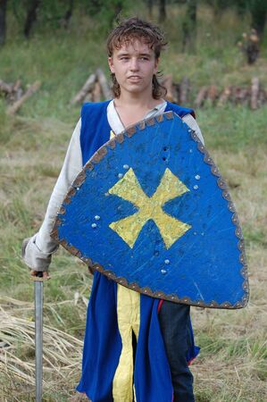 KIEV, UKRAINE - JULY 31: Member of history club Golden Capricorn wears medieval costume as he participates in historical festival and camp in memory of King Vladimir July 31, 2009 in Kiev, Ukraine.  Stock Photo - 8502088