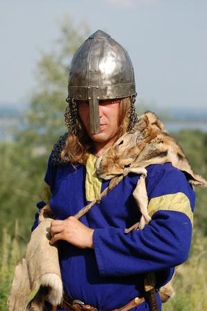 wears: KIEV, UKRAINE - JULY 31: Member of history club Golden Capricorn wears medieval costume as he participates in historical festival and camp in memory of King Vladimir July 31, 2009 in Kiev, Ukraine.