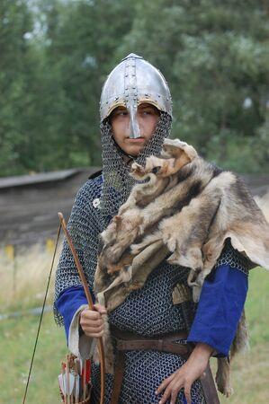 KIEV, UKRAINE - JULY 31: Member of history club Golden Capricorn wears medieval costume as he participates in historical festival and camp in memory of King Vladimir July 31, 2009 in Kiev, Ukraine.  Stock Photo - 8502085