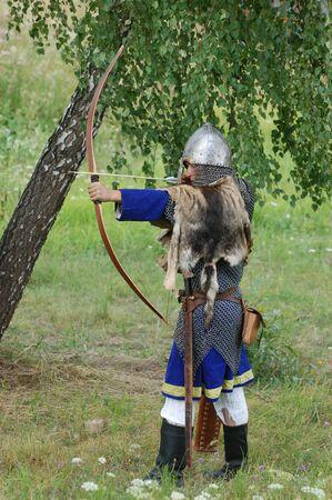 historical battle: KIEV, UKRAINE - JULY 31: Member of history club Golden Capricorn wears medieval costume as he participates in historical festival and camp in memory of King Vladimir July 31, 2009 in Kiev, Ukraine.