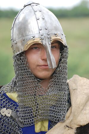 KIEV, UKRAINE - JULY 31: Member of history club Golden Capricorn wears medieval costume as he participates in historical festival and camp in memory of King Vladimir July 31, 2009 in Kiev, Ukraine.  Stock Photo - 8502062