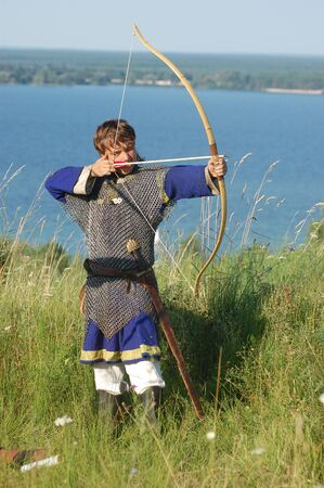 KIEV, UKRAINE - JULY 31: Member of history club Golden Capricorn wears medieval costume as he participates in historical festival and camp in memory of King Vladimir July 31, 2009 in Kiev, Ukraine.  Stock Photo - 8502112