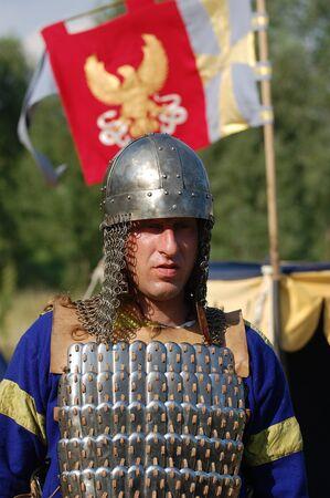 KIEV, UKRAINE - JULY 31: Member of history club Golden Capricorn wears medieval costume as he participates in historical festival and camp in memory King Vladimir July 31, 2009 in Kiev, Ukraine  Stock Photo - 8541123