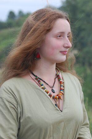 wears: KIEV, UKRAINE - JULY 31: Member of history club Golden Capricorn wears medieval costume as she participates in historical festival in memory of King Vladimir July 31, 2009 in Kiev, Ukraine.