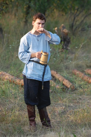 wears: KIEV, UKRAINE - JULY 31: Member of history club Golden Capricorn wears medieval costume as he participates in historical festival and camp in memory King Vladimir July 31, 2009 in Kiev, Ukraine  Editorial