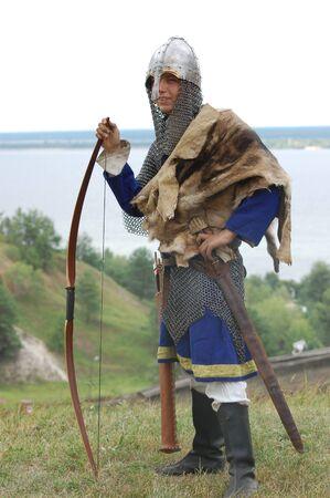 KIEV, UKRAINE - JULY 31: Member of history club Golden Capricorn wears medieval costume as he participates in historical festival and camp in memory King Vladimir July 31, 2009 in Kiev, Ukraine