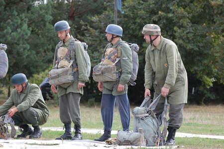 chernigow: CHERNIGOW, UKRAINE - AUG 29: Members of Red Star military history club wear historical German paratrooper uniform during historical reenactment of WWII, August 29, 2010 in Chernigow, Ukraine