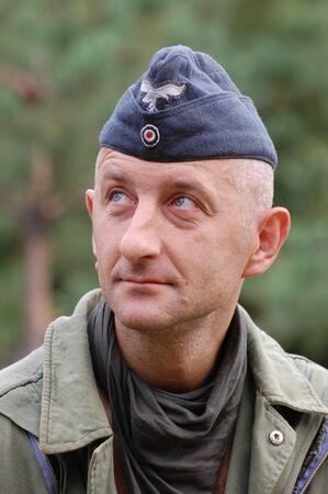 chernigow: CHERNIGOW, UKRAINE - AUG 29: Member of Red Star military history club wears historical German uniform during historical reenactment of WWII, August 29, 2010 in Chernigow, Ukraine