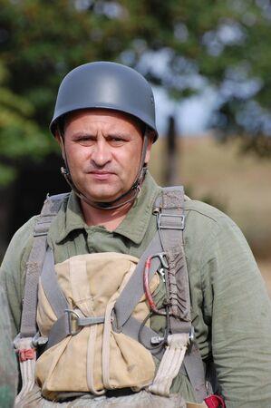 chernigow: CHERNIGOW, UKRAINE - AUG 29: An unidentified member of Red Star military history club wears historical German uniform during historical reenactment of WWII, August 29, 2010 in Chernigow, Ukraine