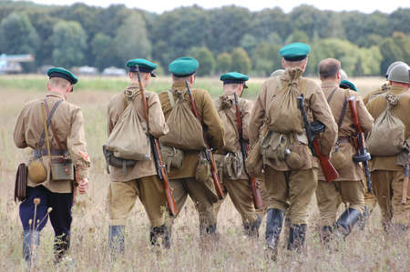 chernigow: CHERNIGOW, UKRAINE - AUG 29: Members of Red Star military history club wear historical Soviet uniform during historical reenactment of WWII, August 29, 2010 in Chernigow, Ukraine  Editorial