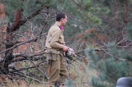 chernigow: CHERNIGOW, UKRAINE - AUG 29: A member of Red Star military history club wears historical Soviet uniform during historical reenactment of WWII, August 29, 2010 in Chernigow, Ukraine  Editorial