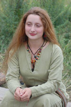 KIEV, UKRAINE - JULY 31: Member of history club Golden Capricorn wears medieval costume as she participates in historical festival in memory of King Vladimir July 31, 2009 in Kiev, Ukraine.