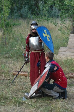 weaponry: KIEV, UKRAINE - JULY 31: Member of history club Golden Capricorn wears medieval costume as he participates in historical festival and camp in memory King Vladimir July 31, 2009 in Kiev, Ukraine