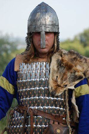 historical battle: KIEV, UKRAINE - JULY 31: Member of history club Golden Capricorn wears medieval costume as he participates in historical festival and camp in memory King Vladimir July 31, 2009 in Kiev, Ukraine