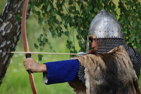 KIEV, UKRAINE - JULY 31: Member of history club Golden Capricorn wears medieval costume as he participates in historical festival and camp in memory King Vladimir July 31, 2009 in Kiev, Ukraine Stock Photo - 8707322