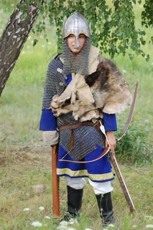 KIEV, UKRAINE - JULY 31: Member of history club Golden Capricorn wears medieval costume as he participates in historical festival and camp in memory King Vladimir July 31, 2009 in Kiev, Ukraine Stock Photo - 8707345