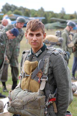 chernigow: CHERNIGOW, UKRAINE - AUG 29: Member of Red Star military history club wears historical German paratrooper uniform during historical reenactment of WWII, August 29, 2010 in Chernigow, Ukraine