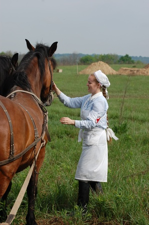 KIEV, UKRAINE - MAY 10 : member of Red Star history club wears historical military German paramedic uniform during historical reenactment of 1945 WWII, May 10, 2010 in Kiev, Ukraine