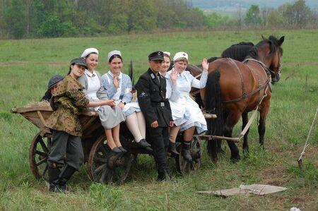 KIEV, UKRAINE - MAY 10 : members of Red Star history club wear historical military German paramedic uniform during historical reenactment of 1945 WWII, May 10, 2010 in Kiev, Ukraine
