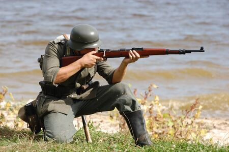 vintage military rifle: German soldier.WW2 historical reenactment