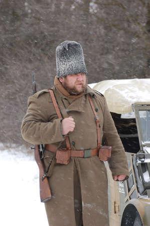 wears: KIEV, UKRAINE - FEB 20: Member of Red Star military history club wears historical Romanian uniform during historical reenactment of WWII,February 20, 2011 in Kiev, Ukraine