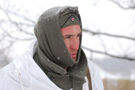 wears: KIEV, UKRAINE - FEB 20: Member of Red Star military history club wears historical German uniform during historical reenactment of WWII,February 20, 2011 in Kiev, Ukraine Editorial