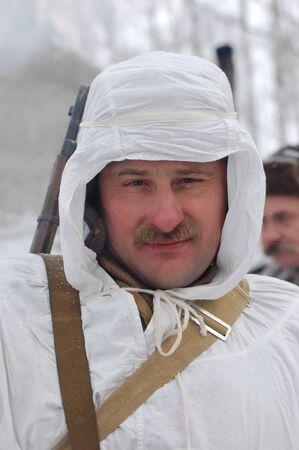 KIEV, UKRAINE - FEB 20: A member of military history club Red Star wears historical Soviet uniform during historical reenactment of WWII,February 20, 2011 in Kiev, Ukraine Stock Photo - 8995462